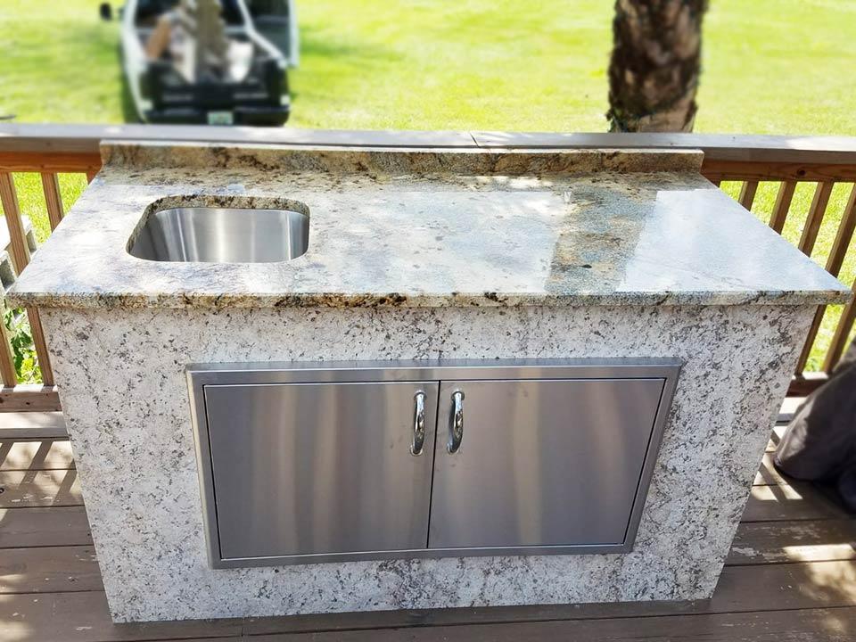 small granite outdoor kitchen